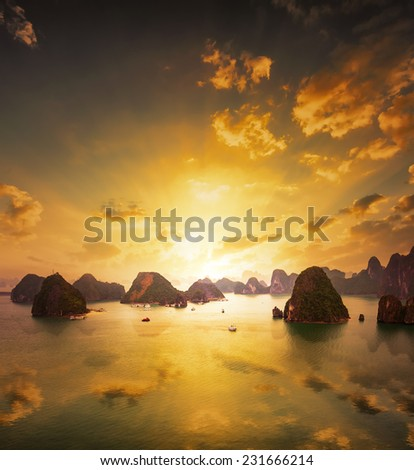 Sunset over the islands of Halong Bay in northern Vietnam. Amazing landscape background - stock photo