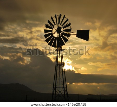 Sunset over the Karoo South Africa (Windpomp Silhouette) - stock photo