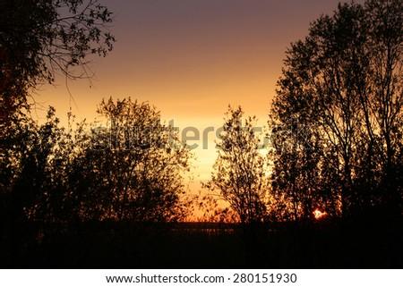 Sunset over the lake Lahta - stock photo