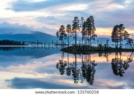 Sunset over the lake. Sweden Reflection. - stock photo