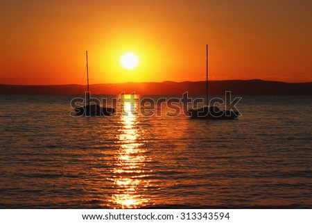 Sunset over the lake with ships