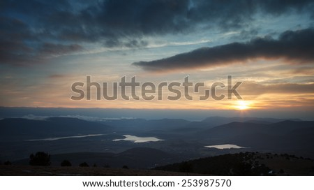 Sunset over the mountain hills - stock photo