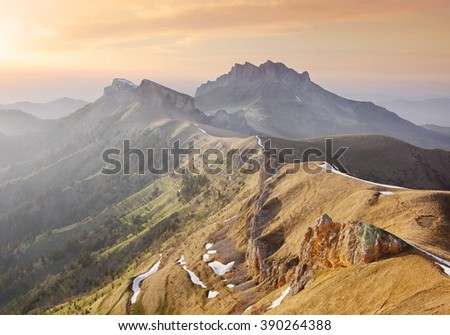 Sunset over the mountains. - stock photo