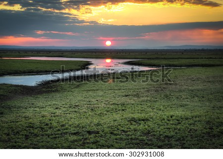 Sunset over the National Park Gorongosa in the center of Mozambique  - stock photo