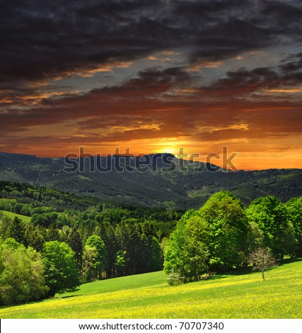 sunset over the national park Sumava in Czech Republic - stock photo