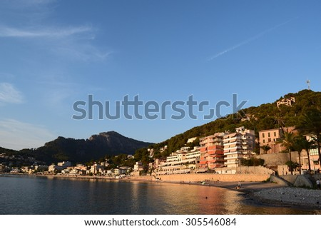 Sunset over the natural harbor of Port de Soller on Majorca, Spain.