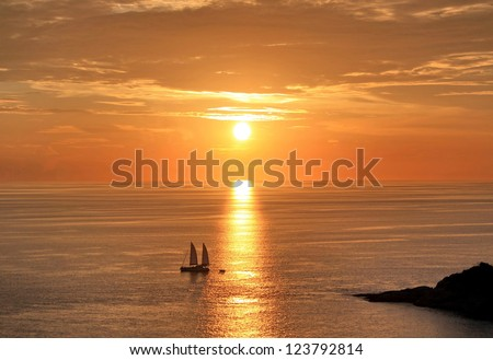 Sunset over the ocean with orange sky, Phuket island ,Thailand