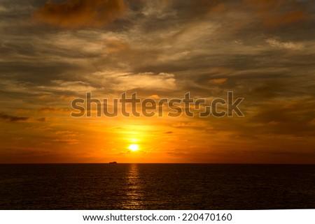 sunset over the Pacific ocean in Mazatlan - stock photo