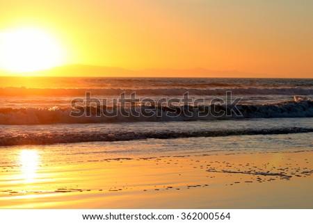 Sunset over the Pacific Ocean in Ventura California. - stock photo