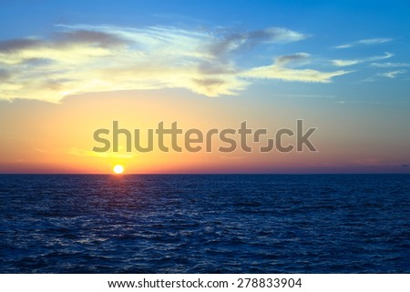 Sunset over the Pacific ocean viewed from Cavancha beach in Iquique, Chile. Iquique is a popular beach town and free port city in Northern Chile.  - stock photo