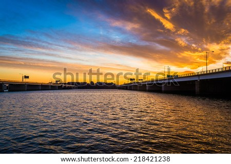 Sunset over the Potomac River and bridges in Washington, DC. - stock photo