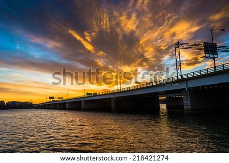 Sunset over the Potomac River and George Mason Memorial Bridge in Washington, DC. - stock photo