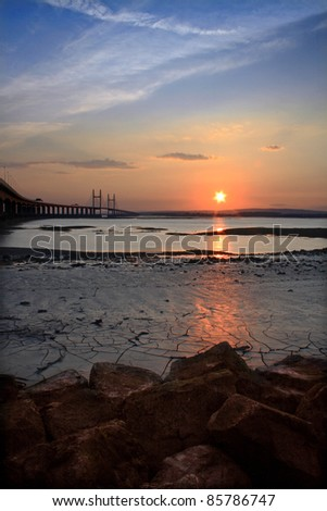 Sunset over the River Severn and Suspension Bridge, English Channel, UK - stock photo