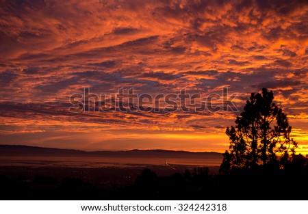 Sunset over the San Mateo bridge and the San Francisco Bay - stock photo