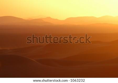 Sunset over the sand dunes of Erg Chebbi in the Sahara Desert near Merzouga, Morocco. - stock photo