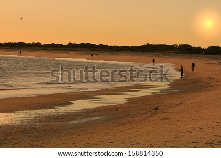 Sunset over the sea and beach - stock photo