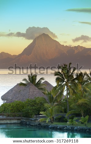 Sunset over the sea and mountains,  Tahiti.