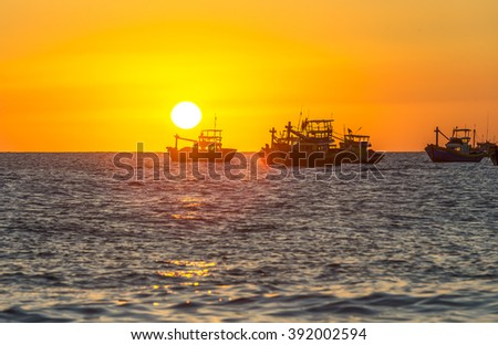 Sunset over the sea as the sun pier horizon rounded bottom makes sunset boat with yellow sky it's great to watch - stock photo