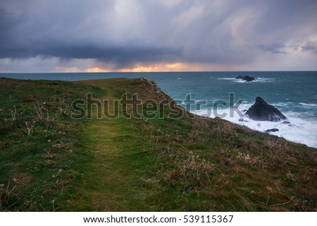 Sunset over the sea during a storm. Photo taken in Cornwall, England.