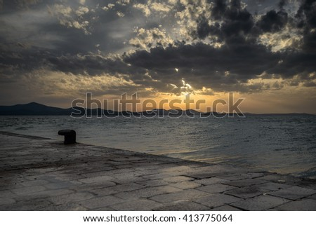 Sunset over the sea during summer evening in Croatia - stock photo