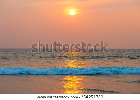 sunset over the sea in orange color - stock photo