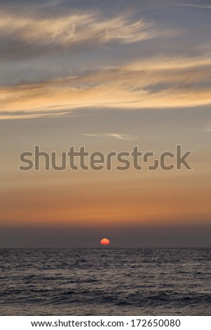 Sunset over the sea in The Netherlands - stock photo