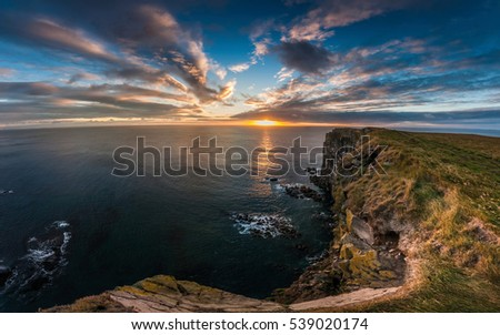 Sunset over the sea in westernmost part of Iceland, named Latrabjarg