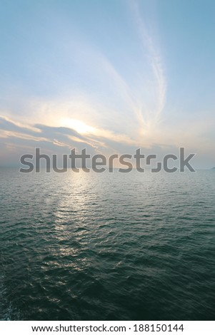 sunset over the sea on the island of Koh Samui in Thailand - stock photo