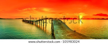 Sunset over the sea. Pier on the foreground. Panorama - stock photo