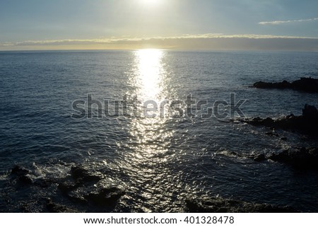 Sunset  over  the sea. Tenerife  south . Canary  Islands . Spain.