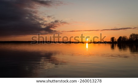 sunset over the sea with dramatic colorful sky