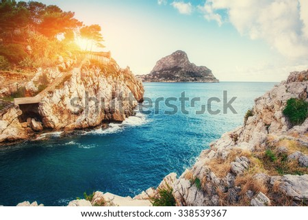 Sunset over the sea with rocks in Italy. Sicily