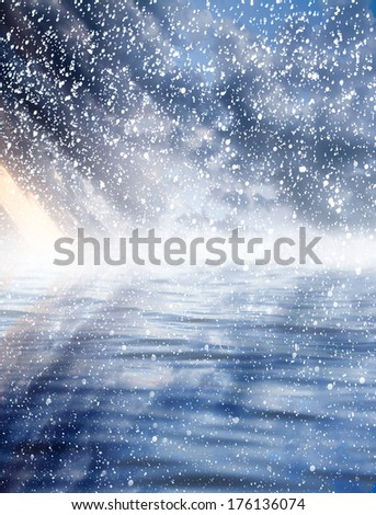 sunset over the sea with snow - stock photo