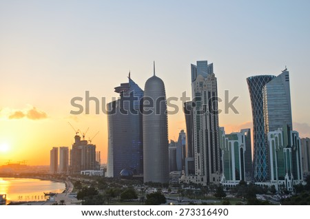 Sunset over the skyscrapers in the skyline of the commercial center of Doha, the capital of the Arabian Gulf state Qatar.