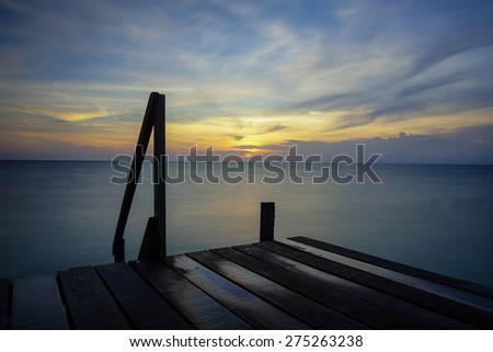 Sunset over the small jetty at Mabul Island, Sabah, Malaysia - stock photo