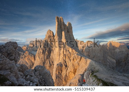 Sunset over the Vajolet towers in Dolomites, stars in the background