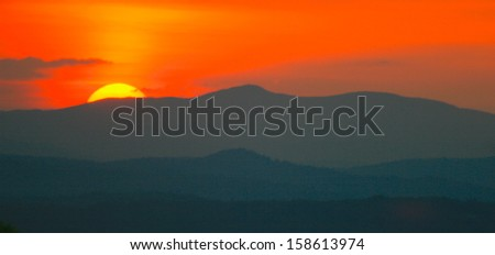 Sunset over the White Mountains of New Hampshire taken from Gilford New Hampshire - stock photo