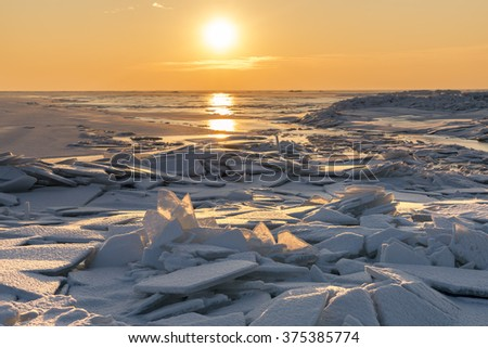 sunset over the winter sea  - stock photo