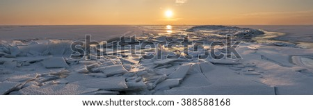 sunset over the winter sea panorama