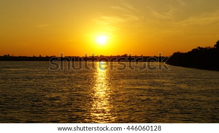 Sunset over the Zambezi River in Zambia, a sunbeam on the water/Sunset in Africa - stock photo