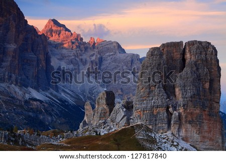 Sunset over Tofana di Rozes and Cinque Torre, Dolomite Alps, Italy - stock photo