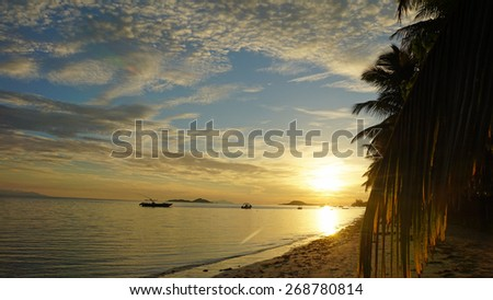 sunset over tropical bay on seychelles