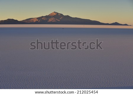 Sunset over Uyuni Salt Flat,  Salar de Uyuni,  world's largest salt flat, Bolivia, - stock photo