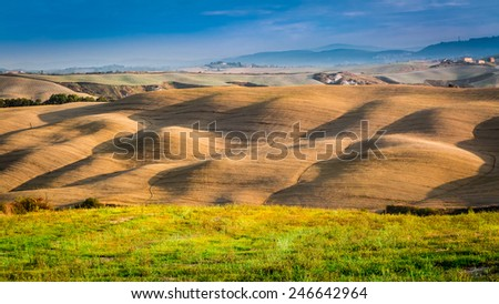 Sunset over valley in the Tuscany - stock photo