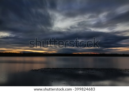 Sunset over Volga River with beautiful clouds, located in Russia