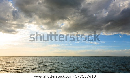 "Sunset over water from ""Delta del Po"", Italian landscape. water and sky"