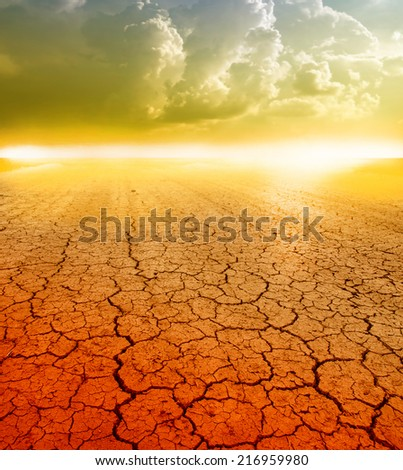 sunset ower a dry land - stock photo