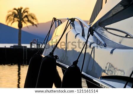 Sunset palm & yacht - stock photo