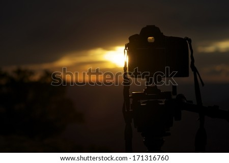 Sunset Photography. Digital Camera on Tripod in Sunset. Photography Theme. - stock photo