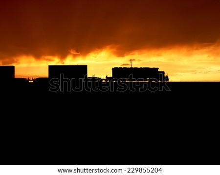 sunset railway train - stock photo